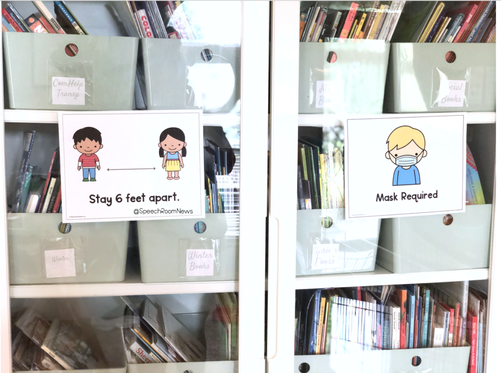 Posters on a library cabinet door.