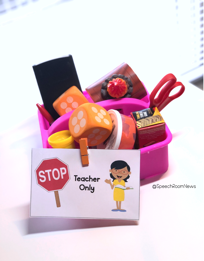 """A bucket of speech therapy materials with a sign that says """"stop teacher only""""."""