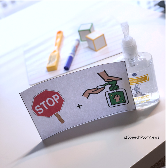 "Speech therapy materials with a sign in front that say ""stop and use hand sanitizer""."